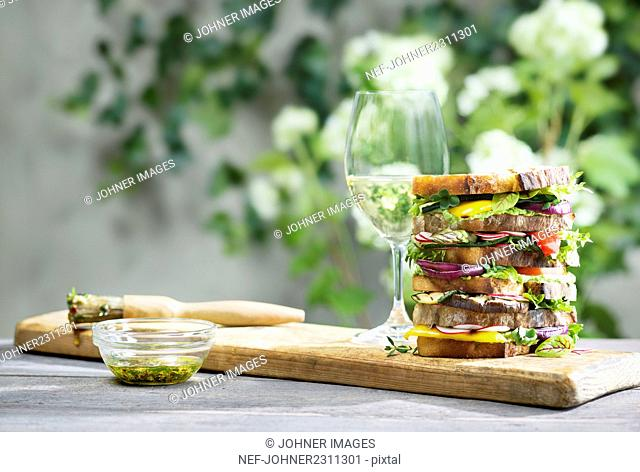 Large sandwich and white wine