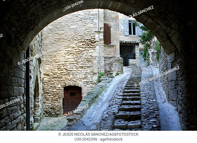 Typical paved street in Gordes village, labeled The Most Beautiful Villages of France, Vaucluse department, Provence-Alpes-Cote d'Azur region. France
