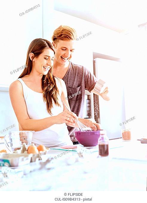 Couple preparing food in kitchen
