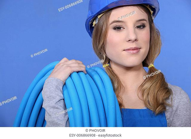 Attractive woman holding corrugated tubing