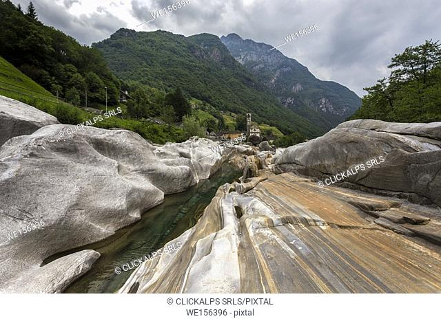 The rocks on the bed of river Verzasca and the church of Lavertezzo, Valle Verzasca, Canton Ticino, Switzerland