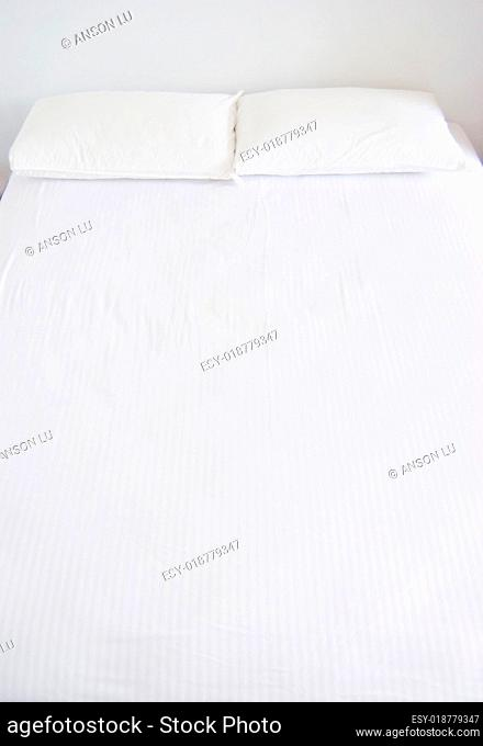 white bedroom with white beddings