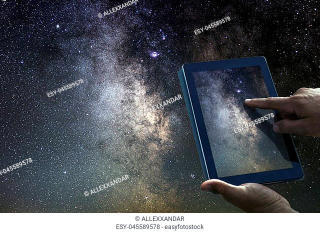 Space Astronomy Exploration Concept. Night Sky tablet Milky Way Galaxy