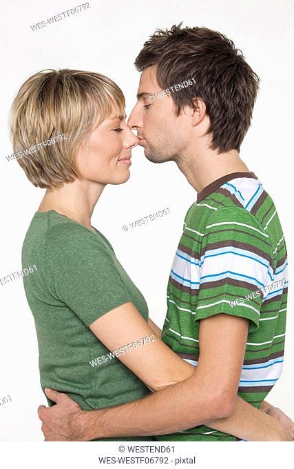 Couple kissing, side view, portrait