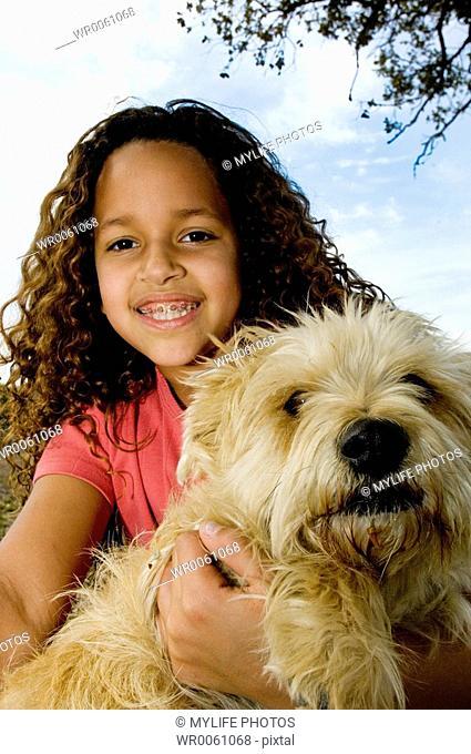 holding her dog