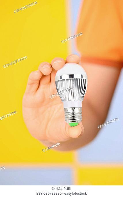 Men holding modern LED bulb in his hand