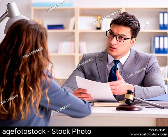 The lawyer discussing legal case with client