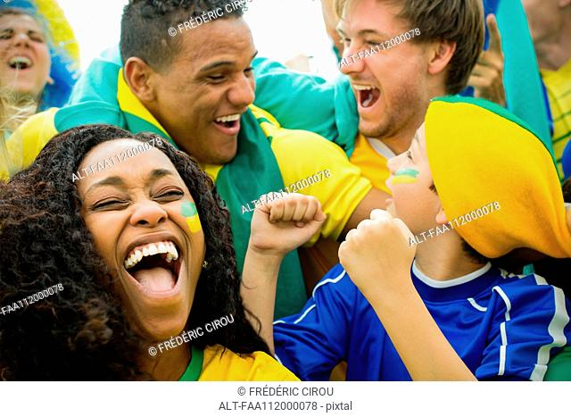 Brazilian football fans celebrating victory at match