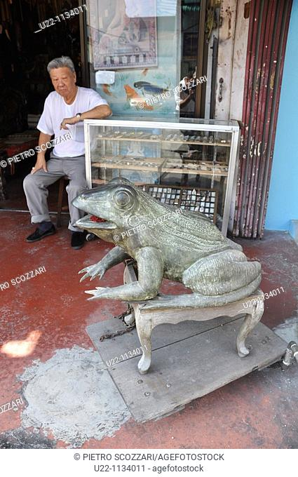 George Town, Penang (Malaysia): antique shop along Lebuh Chulia, with a good luck, frog-shaped statue at the entrance