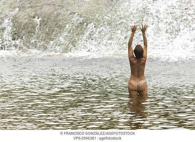 Woman of 40 years bathing in the river World in Lietor in the province of Albacete, Spain