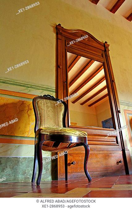 Chair and mirror, Mas Turro cottage, Les Gavarres, Baix Emporda, Catalonia, Spain