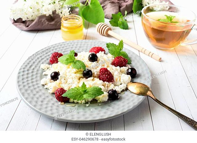 Russian cottage cheese with berries, honey mint, selective focus, healthy Breakfast