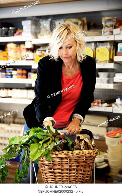 Mature woman doing shopping
