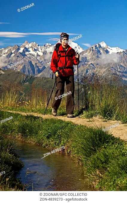 Hiker on a hike along the historic Verbier canal