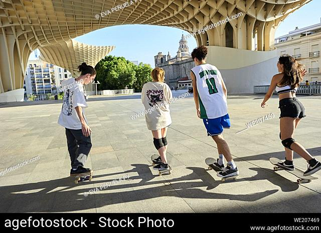 Group of young people riding on skateboard in the city