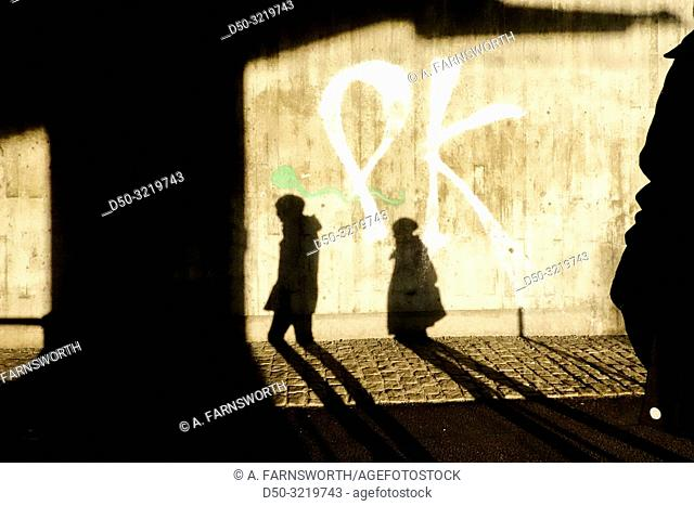 Stockholm, Sweden Pedestrians in a passageway in the winter light in Liljeholmen