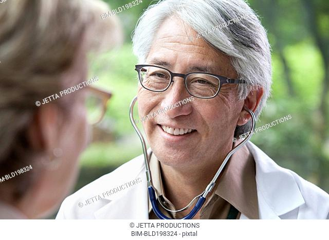 Asian doctor examining patient