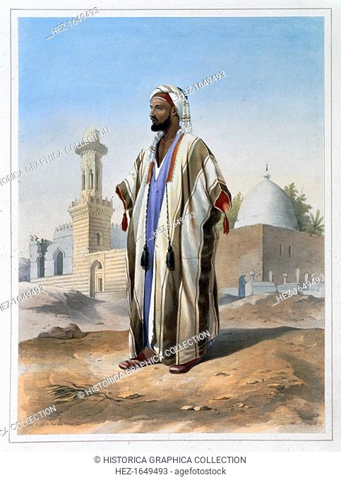 A fellah dressed in a haba, 1848. A fellah is a peasant farmer or agricultural labourer in Egypt and the Middle East. Illustration from The Valley of the Nile...