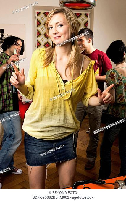 portrait of young woman dancing at party