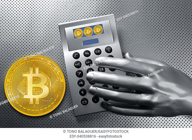 calculator with bitcoin btc coin and futuristic silver hand