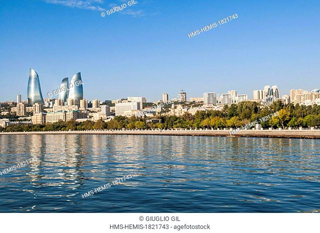 Azerbaijan, Baku, Flame Towers by architects Hellmuth, Obata & Kassabaum view from the edge of Caspian Sea along the Neftciler Prospekt avenue also called...