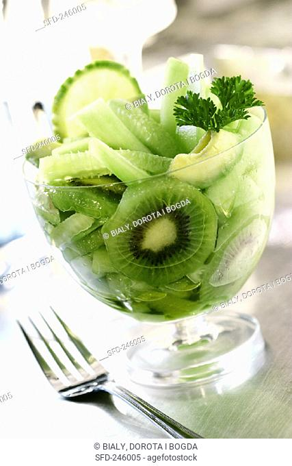 Green salad of kiwi fruits, cucumber and avocados
