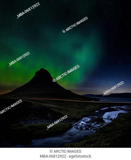 Aurora Borealis over Mt Kirkjufell and waterfall, Snaefellsnes Peninsula, Iceland