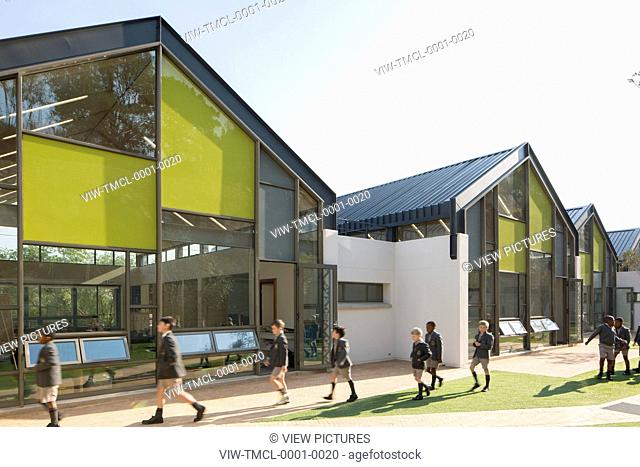 Three classrooms exterior with schoolboys passing. St Johns College Pre Preparatory, Johannesburg, South Africa. Architect: TC Design Architects, 2015