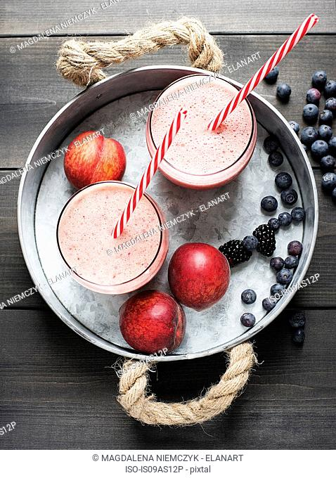Fresh fruit smoothies with nectarines and blackberries