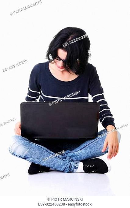 Young thoughtful woman with a laptop