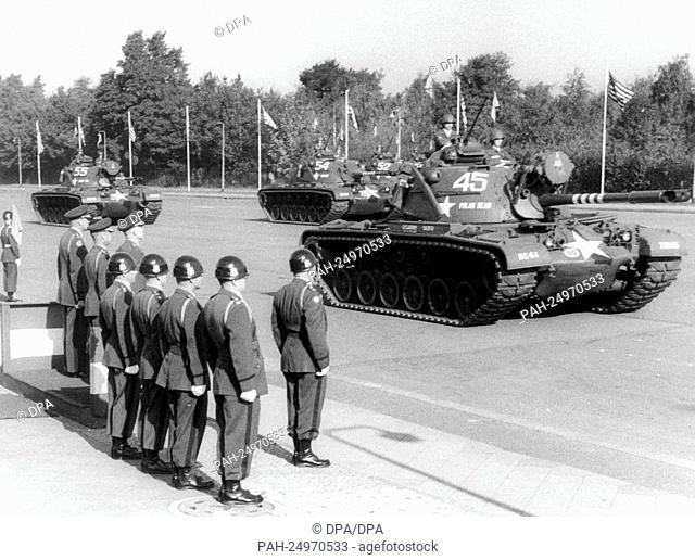Tanks of the US Army driving past the VIP stand with the commanding generals on occasion of a military parade of the US troops for the 11th anniversary of their...