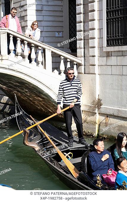 Gondolier and gondola, Venice, Italy