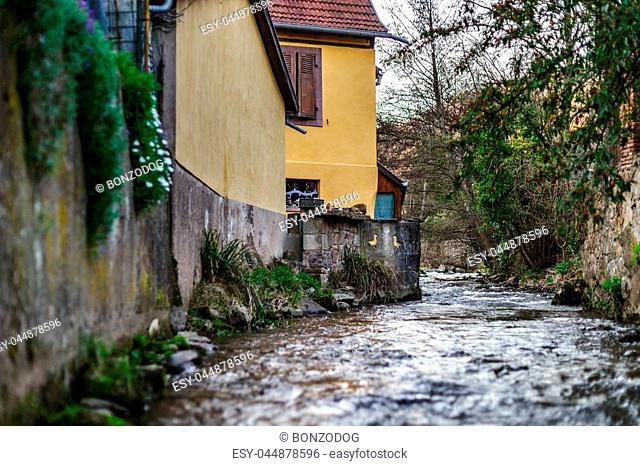 Andlau river in little alsacien village, France, springtime