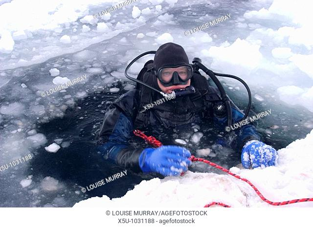 Canadian High Arctic, Lancaster Sound, Nunavut Canada May 2004 Australian photographer Kelvin Aitken at the surface before ice diving