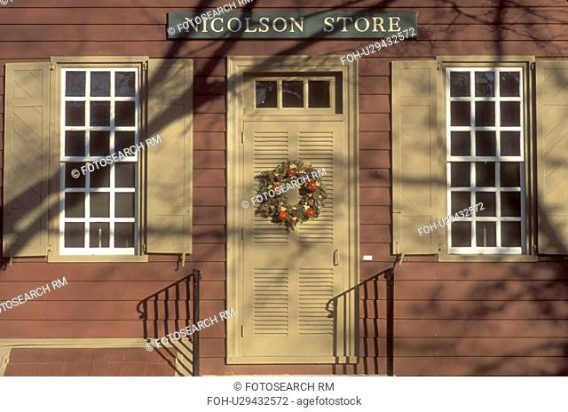 Colonial Williamsburg, Virginia, VA, Williamsburg, A wreath made of greens and fruit decorate the door of Nicholson Store for Christmas in Colonial Williamsburg