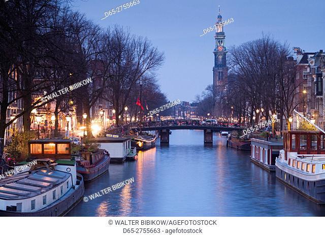 Netherlands, Amsterdam, along Prinsengracht canal, towards Westerkerk church dusk