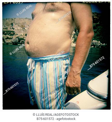Fat stomach of a young man