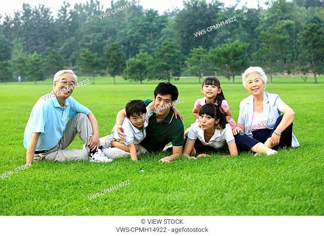 Family of six in grass