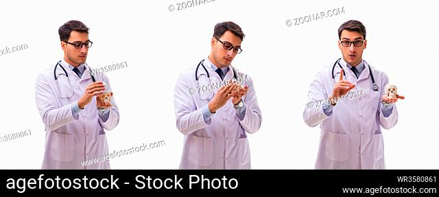 Young male doctor with skeleton isolated on white