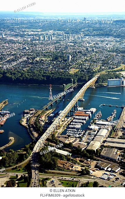 Iron Workers Memorial Bridge from North Vancouver to East Vancouver across the Burrard Inlet with Delta in the background and Burnaby in the mid ground