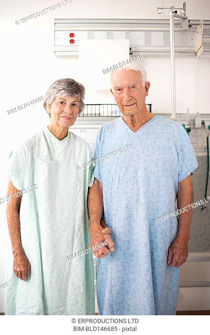 Husband and wife patients in hospital gowns