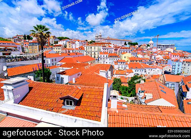 View of the city & Tagus River from Miradouro de Santa Luzia, an observation deck in Lisbon, Portugal