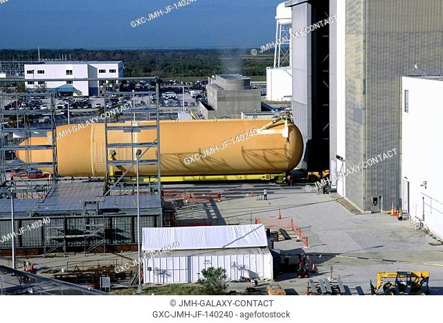 Viewed from the roof of the Launch Control Center in the Launch Complex 39 Area, the newly redesigned External Tank is seen moving into the Vehicle Assembly...