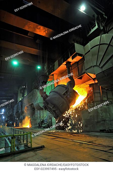 Molten hot steel pouring in steel plant