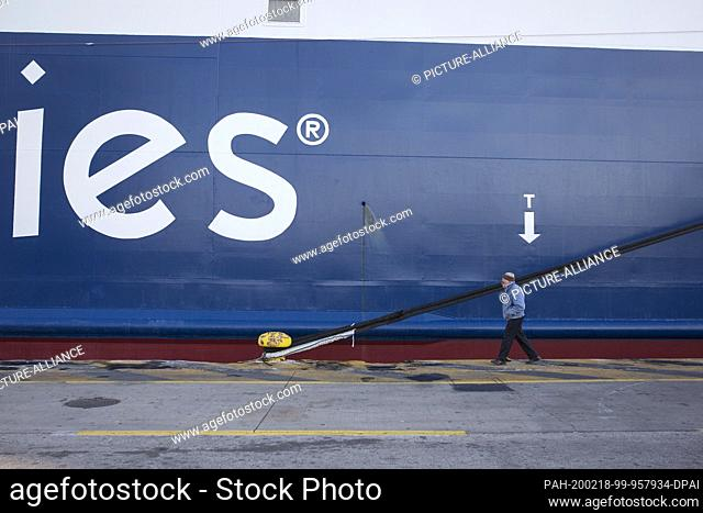 18 February 2020, Greece, Piräus: A man walks along a docked ferry in the port of Piraeus during a 24-hour strike. Extensive strikes today have led to...