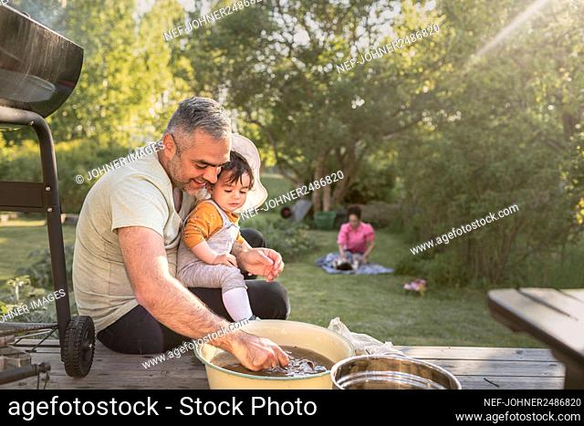 Father with toddler in garden