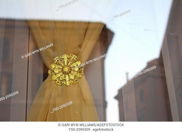 gold clip on curtains in hotel window in rome italy