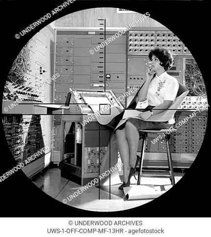 Syosset, New York: 1963. A Sperry Rand secretary is the focus of the periscope function of the new 1. 5 million dollar Dynamic Simulator computer developed for...