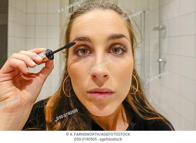 Stockholm, Sweden A 24 year old woman puts makeup on before going out on a Saturday night