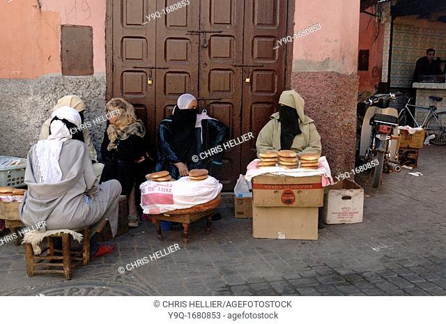 Veiled Women Selling Bread Marrakesh or Marrakech Morocco